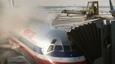 An American Airlines jet is de-iced at O'Hare Airport in Chicago on December 9. Wintry conditions have caused numerous flight cancellations and delays.