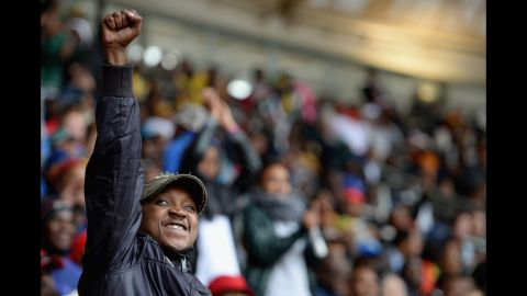 A man raises his fist during the memorial service.
