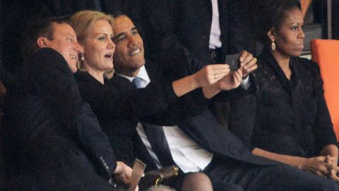 Denmark's Prime Minister Helle Thorning-Schmidt snaps a selfie with British Prime Minister David Cameron and U.S. President Barack Obama during the memorial service of former South African President Nelson Mandela in Johannesburg on Tuesday, December 10.