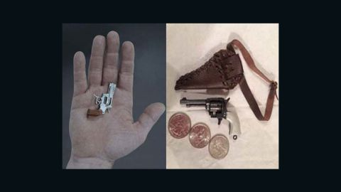 The Swiss Mini Gun, left, is the world's smallest known working gun. The toy gun on the right was confiscated by the TSA.