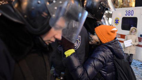 Police enter Independence Square on December 11.