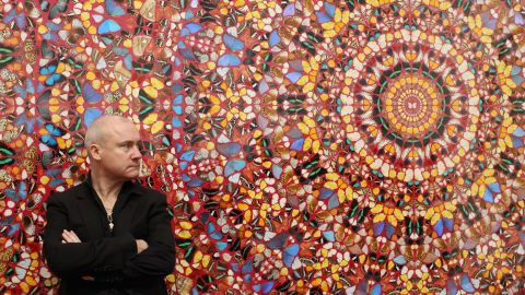 """Hirst, possing in front of his artwork """"I am Become Death, Shatterer of Worlds"""" at London's Tate Modern on April 2, 2012, rose to fame in the 1990s as one of the Young British Artists, or YBAs, along with Tracey Emin, Sarah Lucas and Jake and Dinos Chapman."""