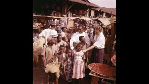 Graham visits with children during a trip to Ghana in 1960.