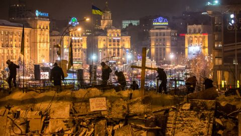 Anti-government protesters use snow to reinforce a barricade blocking street access to Independence Square, known as the Euromaidan, on December 11, 2013 in Kiev, Ukraine.