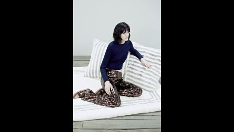 Here, Marc Jacobs paired sequined stripe pants with a navy cashmere sweater in the 2014 resort collection.