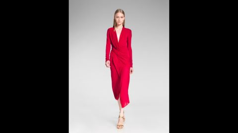 """Not sure what it means when that holiday party invitation suggests you """"dress festively""""? Try these trends for inspiration. This festive red outfit from the 2014 Donna Karan resort presentation is perfect for a party."""