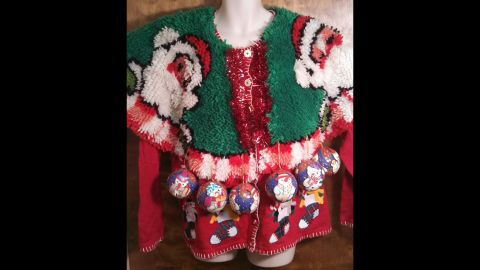 """Blackman likes to further embellish her """"ugly"""" sweaters with chenille fringe and Christmas tree ornaments."""