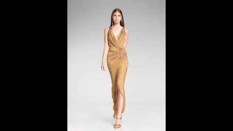 """Donna Karan's 2014 resort collection reflected the growing trend of metallic solids. A classic gold-and-black or silver-and-black outfit will work in a pinch when you're required to """"dress festively."""""""