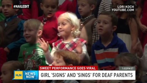 Newsnow girl signs and sings for deaf parents _00014911.jpg