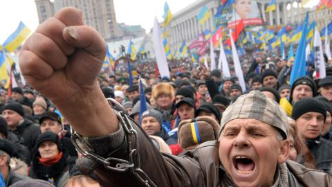 A man shouts slogans during a mass rally called 'The March of a Million' on Kiev's Independence Square on December 8, 2013.
