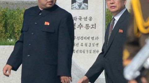Kim Jong Un, left, and Jang Song Thaek walk through a cemetery for Korean War veterans on July 25 in Pyongyang, North Korea, marking the 60th anniversary of the signing of the armistice that ended hostilities on the Korean peninsula.
