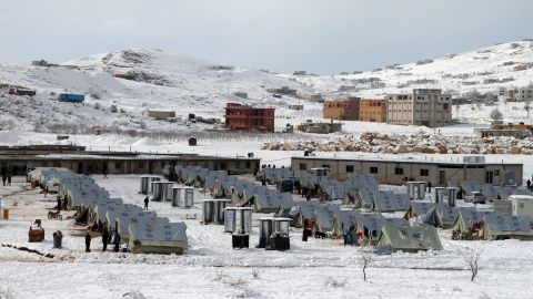 Snow covers the ground at a refugee camp in Arsal on Friday, December 13.