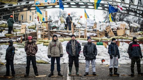 Anti-government protesters guard a barricade designed to keep police from evicting them from Independence Square on Friday, December 13.
