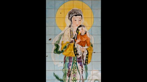 A painted tile artwork from China at the Church of the Annunciation in Nazareth, Israel, depicts Mary and Jesus.