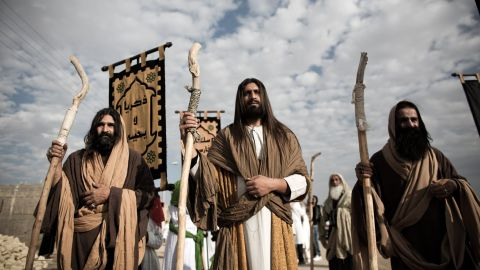 """An Iranian Muslim Shiite man, acting as Jesus, center, takes part in the annual religious performance of """"Taazieh"""" in the Iranian town of Noosh Abad on November 12, 2013."""
