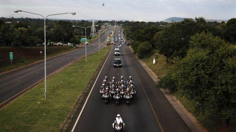 Motorcycles escort Mandela's hearse.