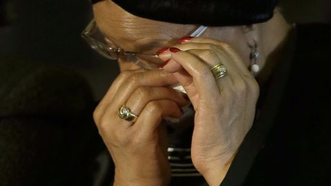 Mandela's widow, Graca Machel, wipes her eyes during the farewell ceremony for her husband.