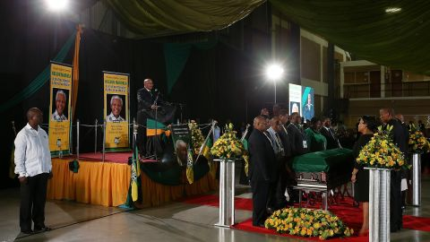 South African President Jacob Zuma speaks during an African National Congress-led alliance send-off ceremony at Waterkloof air base in Pretoria before the final journey of Mandela's body to his hometown of Qunu for burial.