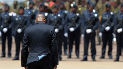 President Jacob Zuma awaits the cortege of Mandela at the Waterkloof air base in Pretoria.
