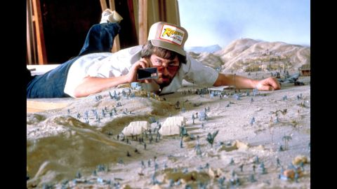 """Spielberg works on a miniature set for """"Raiders of the Lost Ark."""" The 1981 movie would be the first in the highly successful Indiana Jones film franchise."""