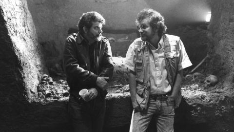 """Executive producer George Lucas, left, and Spielberg confer on the set of the film """"Indiana Jones and the Last Crusade"""" in 1989. The two influential filmmakers have worked on multiple movies together."""