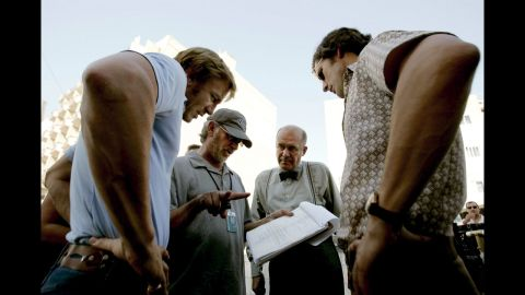 """Spielberg, second from left, talks with actors Daniel Craig, Hanns Zischler and Eric Bana on the set of """"Munich"""" in 2005. The movie is based on the hostage crisis that took place during the 1972 Munich Olympics."""
