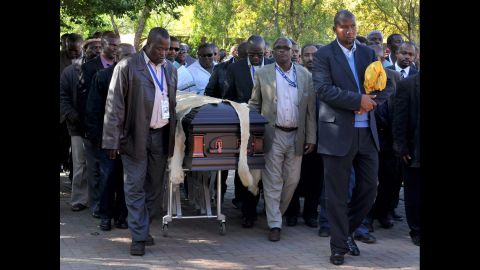 Nelson Mandela's grandson Mandla Mandela, center, leads local chiefs as they escort the lion-skin-draped casket of Mandela in Qunu on December 14.