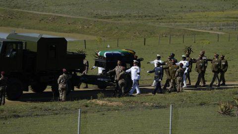 Mandela's casket is escorted to the funeral ceremony on December 15.