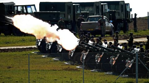 A 21-gun salute is fired as the funeral procession carrying the casket of Mandela moves through Qunu.