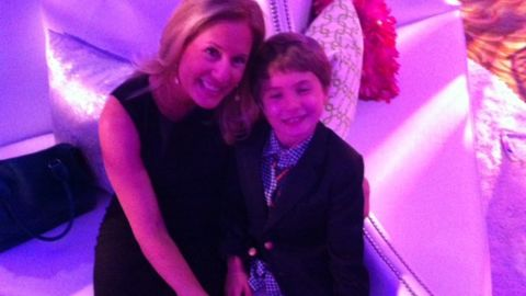 """Single mom Beth Engelman, co-founder of the site <a href=""""http://mommyonashoestring.com/"""" target=""""_blank"""" target=""""_blank"""">Mommy on a Shoestring</a>, joined other families in her community and adopted a classroom in downtown Chicago. Her son Jackson was responsible for buying gifts for two second-graders like himself. """"Buying gifts for these kids who asked for shoes, clothes and an Easy Bake Oven meant more to me and Jackson than anything we could buy for ourselves,"""" Engelman said."""