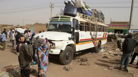South Sudanese pack their belongings on a bus before their trip back to the South in Khartoum on Saturday.