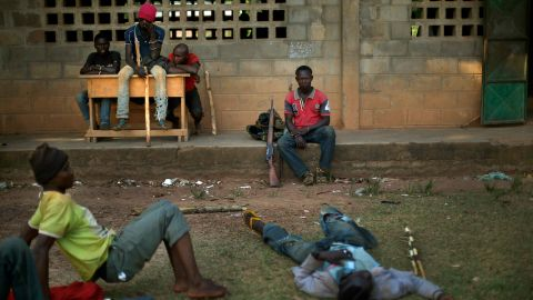 Former soldiers linked to Christian militiamen rest Sunday, December 15, in a camp set up in a Bangui school. Christian vigilante groups formed to battle Seleka, the predominantly Muslim coalition behind the March removal of President Francois Bozize.