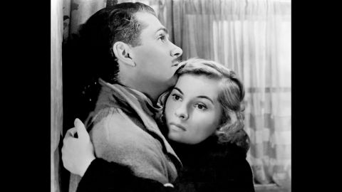 """Fontaine and Laurence Olivier embrace in """"Rebecca,"""" a 1940 film directed by Alfred Hitchcock. For her role in """"Rebecca,"""" Fontaine earned her first Academy Award nomination for Best Actress."""