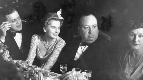 """Fontaine, second from left, sits with producer David Selznick, Hitchcock and Hitchcock's wife, Alma, at the Academy Awards presentation dinner in 1941. """"Rebecca"""" won Best Picture that year."""
