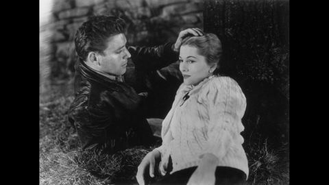 """Burt Lancaster caresses Fontaine's head in the 1948 film """"Kiss the Blood Off My Hands."""""""