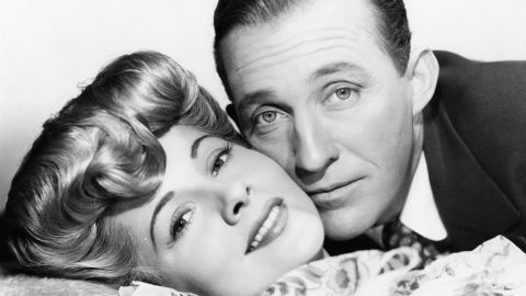 """Fontaine and Bing Crosby, cheek to cheek in a scene from the film """"The Emperor Waltz"""" in 1948."""