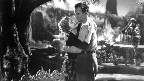 """Fontaine and Joseph Cotten act out a romantic scene from the movie """"September Affair"""" in 1950."""