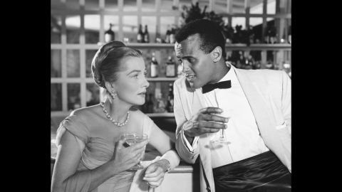 """Fontaine and Harry Belafonte appear in the 1957 film """"Island In the Sun."""""""