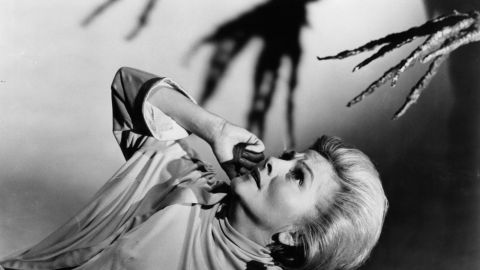 """Fontaine appears scared of the branch-like hand coming at her in a scene from the 1966 film """"The Devil's Own."""""""