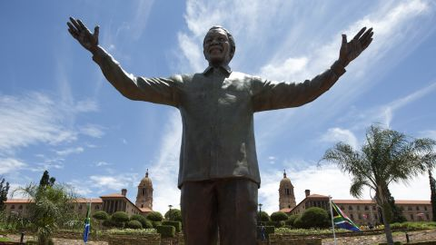 A statue of former South African president Nelson Mandela is unveiled at the Union Buildings on December 16, 2013 in Pretoria, South Africa.