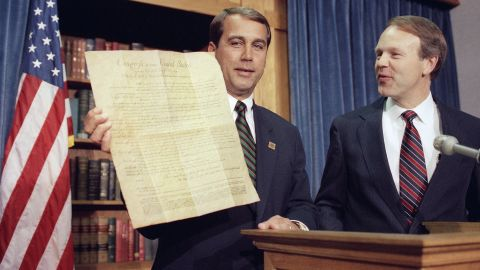 Boehner, R-Ohio, holds a copy of the Constitution on Capitol Hill in Washington on May 7, 1992, as Sen. Don Nickles, D-Oklahoma, looks on. Both men proclaimed it was a historic day when the Michigan House ratified the 27th Amendment to the Constitution, which would require that any Congressional pay raises not go into effect until after the next election.