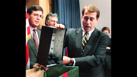 Boehner dumps out coal, which he called a Christmas gift to Pres