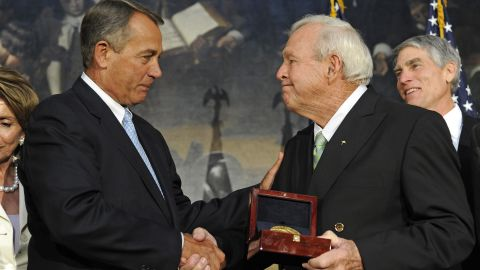 Boehner presents golfing legend Arnold Palmer with the Congressional Gold Medal at a special ceremony in the Rotunda of the Capitol in September 2012.