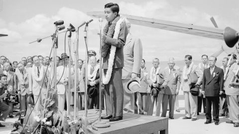 Akihito addresses the crowd upon arrival at Oahu Airport on October 8, 1953, in Honolulu. During seven months of travel, the crown prince visited 14 countries.