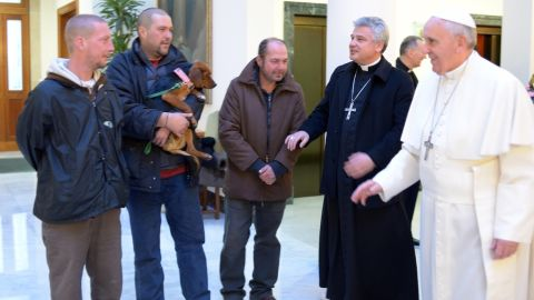 Pope Francis marked his 77th birthday in December 2013 by hosting homeless men at a Mass and a meal at the Vatican. One of the men brought his dog.