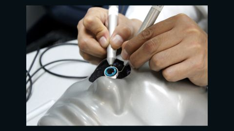 """The plane is fitted with high-tech training equipment, such as this """"cataract simulator."""" A vital part of ORBIS's work is not only treating patients, but training and educating local medics so that they can continue eye treatments long after the Flying Hospital has left."""
