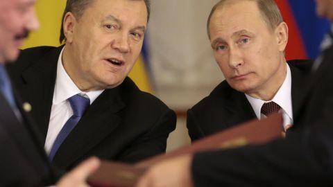 Russian President Vladimir Putin, right, and then-Ukrainian President Viktor Yanukovych in Moscow in 2013.