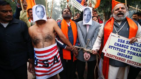 Supporters of right wing Rashtrawadi Shivsena, or nationalist soldiers of Shiva, walk with people representing U.S. President Barack Obama near the U.S Embassy to protest against the alleged mistreatment of New York based Indian diplomat Devyani Khobragade, in New Delhi, India, Wednesday, Dec. 18, 2013.