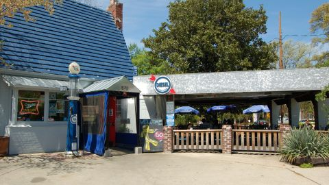 Located in the Virginia Highland neighborhood of Atlanta, Diesel Filling Station is a restaurant and bar that was repurposed from an old Pure Oil filling station. The restaurant preserved the original structure and blue roof.