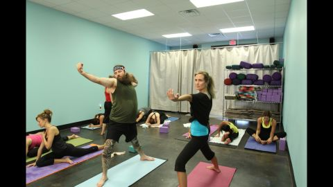 Willie Robertson, one of Phil's sons, does yoga with his wife, Korie, to get ready for their high school reunion. Willie does much of the narrating on the show.